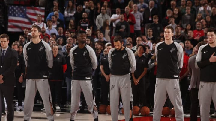 The San Antonio Spurs line up for the national anthem in Portland (Photo by Cameron Browne/NBAE via Getty Images)