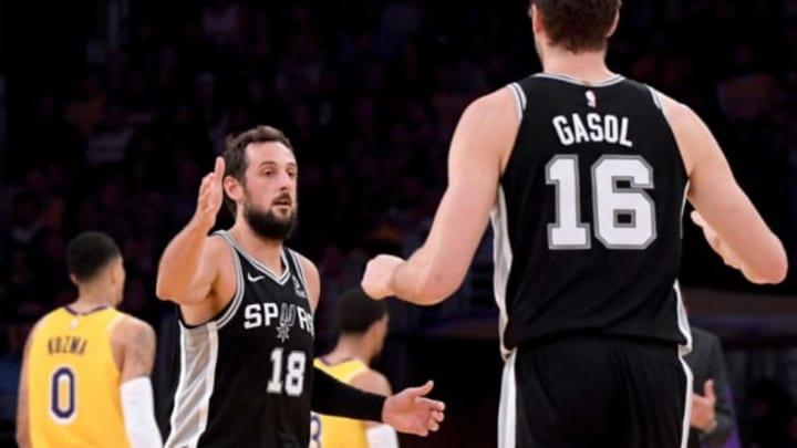 LOS ANGELES, CA – OCTOBER 22: Marco Belinelli #18 of the San Antonio Spurs celebrates after his three pointer with Pau Gasol (Photo by Harry How/Getty Images)