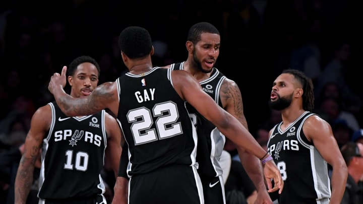 DeMar DeRozan #10, Rudy Gay #22, Patty Mills #8 and LaMarcus Aldridge #11 of the San Antonio Spurs celebrate against the Los Angeles Lakers (Photo by Harry How/Getty Images)