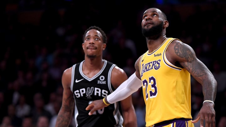 DeMar DeRozan of the San Antonio Spurs stands next to LeBron James (Photo by Harry How/Getty Images)