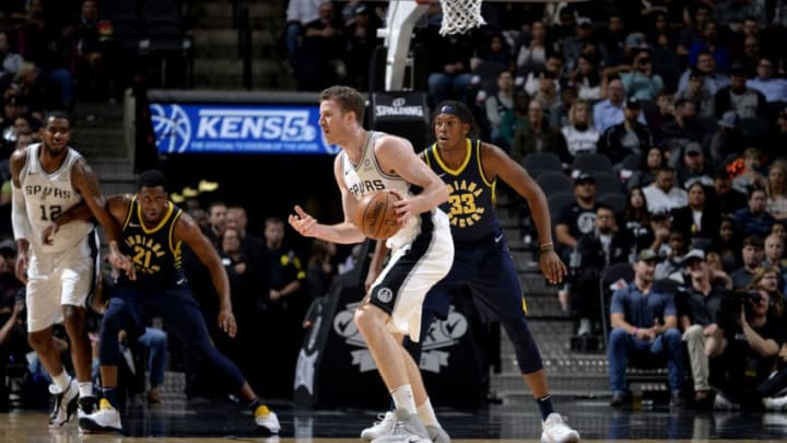 SAN ANTONIO, TX - OCTOBER 24: Jakob Poeltl #25 of the San Antonio Spurs handles the ball against the Indiana Pacers on October 24, 2018 at the AT&T Center in San Antonio, Texas. NOTE TO USER: User expressly acknowledges and agrees that, by downloading and or using this photograph, user is consenting to the terms and conditions of the Getty Images License Agreement. Mandatory Copyright Notice: Copyright 2018 NBAE (Photos by Mark Sobhani/NBAE via Getty Images)