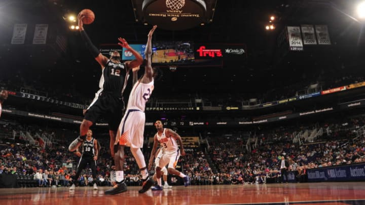 PHOENIX, AZ - OCTOBER 31: LaMarcus Aldridge #12 of the San Antonio Spurs shoots the ball against the Phoenix Suns on October 31, 2018 at Talking Stick Resort Arena in Phoenix, Arizona. NOTE TO USER: User expressly acknowledges and agrees that, by downloading and/or using this Photograph, user is consenting to the terms and conditions of the Getty Images License Agreement. Mandatory Copyright Notice: Copyright 2018 NBAE (Photo by Barry Gossage/NBAE via Getty Images)