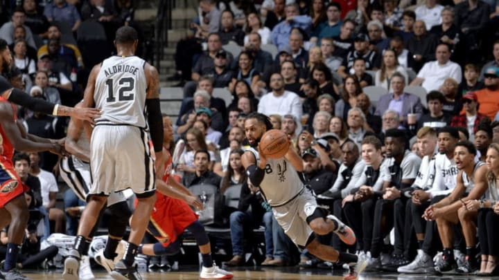 SAN ANTONIO, TX - NOVEMBER 3: Patty Mills #8 of the San Antonio Spurs handles the ball against the New Orleans Pelicans on November 3, 2018 at the AT&T Center in San Antonio, Texas. NOTE TO USER: User expressly acknowledges and agrees that, by downloading and or using this photograph, user is consenting to the terms and conditions of the Getty Images License Agreement. Mandatory Copyright Notice: Copyright 2018 NBAE (Photos by Mark Sobhani/NBAE via Getty Images)