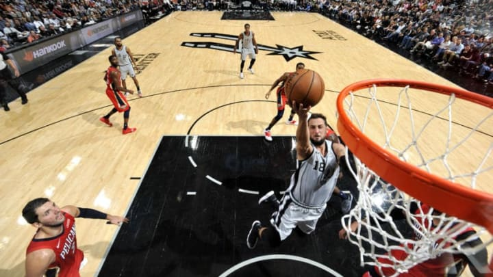 SAN ANTONIO, TX - NOVEMBER 3: Marco Belinelli #18 of the San Antonio Spurs shoots the ball against the New Orleans Pelicans (Photos by Mark Sobhani/NBAE via Getty Images)