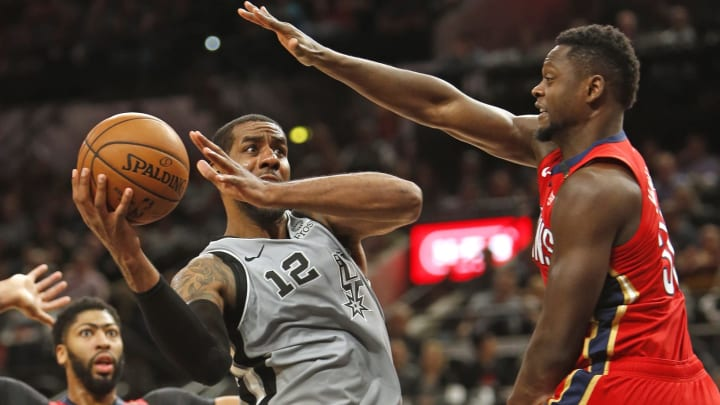 SAN ANTONIO,TX – NOVEMBER 3: LaMarcus Aldridge #12 of the San Antonio Spurs tries to shoot over Julius Randle #30 of the New Orleans Pelicans (Photo by Ronald Cortes/Getty Images)