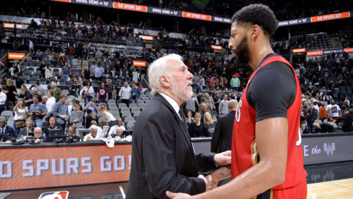 SAN ANTONIO, TX - NOVEMBER 3: Head Coach Gregg Popovich of San Antonio Spurs talks with Anthony Davis #23 of the New Orleans Pelicans after the game on November 3, 2018 at the AT&T Center in San Antonio, Texas. NOTE TO USER: User expressly acknowledges and agrees that, by downloading and or using this photograph, user is consenting to the terms and conditions of the Getty Images License Agreement. Mandatory Copyright Notice: Copyright 2018 NBAE (Photos by Mark Sobhani/NBAE via Getty Images)