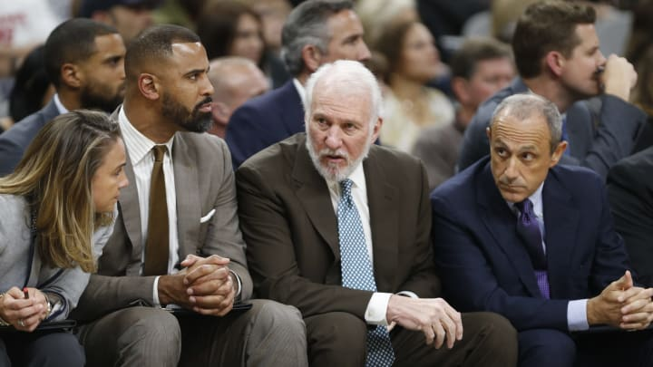 SAN ANTONIO,TX – NOVEMBER 4: Gregg Popovich head coach of the San Antonio Spurs talks with assistant coaches (Photo by Ronald Cortes/Getty Images)