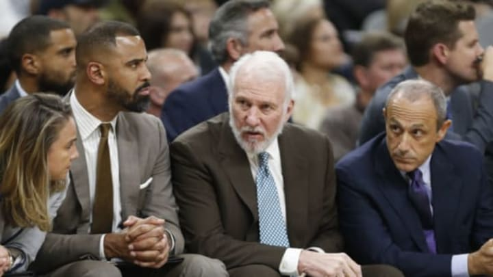 SAN ANTONIO,TX – NOVEMBER 4: Gregg Popovich head coach of the San Antonio Spurs talks with his assistant coaches (Photo by Ronald Cortes/Getty Images)