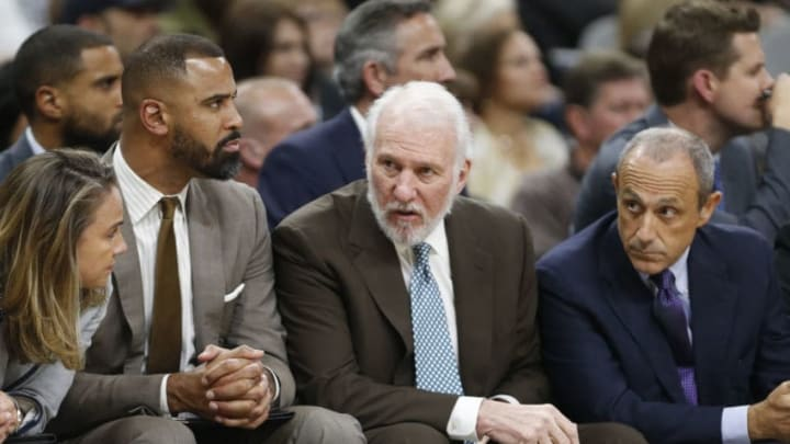 SAN ANTONIO,TX - NOVEMBER 4: Gregg Popovich head coach of the San Antonio Spurs talks with assistant coaches (Photo by Ronald Cortes/Getty Images)