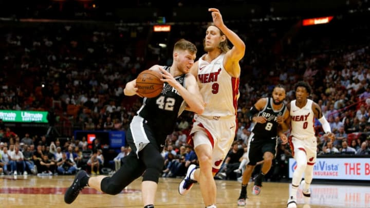 MIAMI, FL - NOVEMBER 07: Davis Bertans #42 of the San Antonio Spurs drives to the basket against Kelly Olynyk #9 of the Miami Heat during the second half at American Airlines Arena on November 7, 2018 in Miami, Florida. NOTE TO USER: User expressly acknowledges and agrees that, by downloading and or using this photograph, User is consenting to the terms and conditions of the Getty Images License Agreement. (Photo by Michael Reaves/Getty Images)