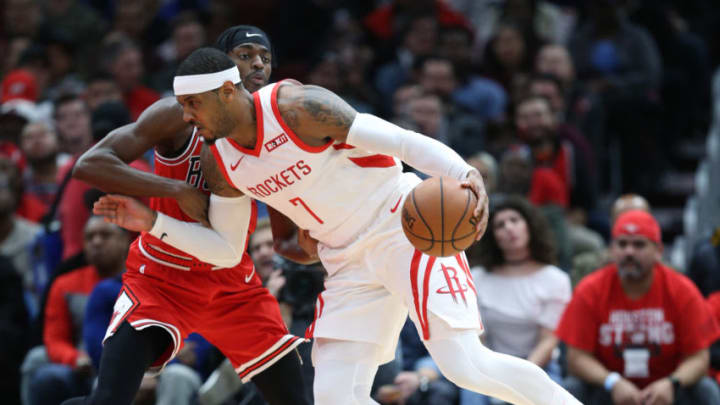 Houston Rockets forward Carmelo Anthony (7) dribbles past the defense of Chicago Bulls forward Justin Holiday (7) in the first quarter at the United Center Saturday, Nov. 3, 2018, in Chicago, Ill. (John J. Kim/Chicago Tribune/TNS via Getty Images)