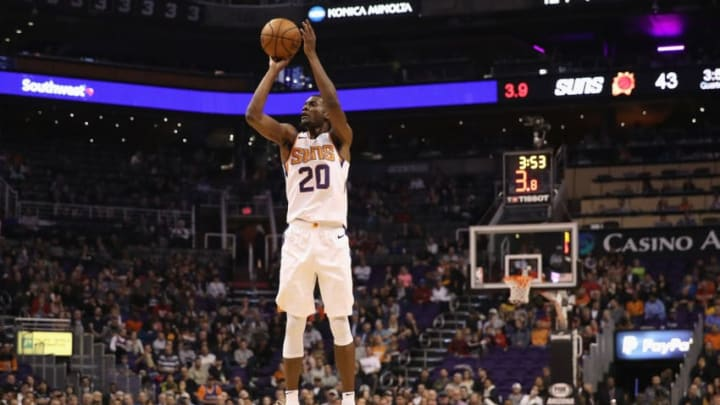 PHOENIX, AZ - NOVEMBER 14: Josh Jackson #20 of the Phoenix Suns puts up a three-point shot against the San Antonio Spurs during the first half of the NBA game at Talking Stick Resort Arena on November 14, 2018 in Phoenix, Arizona. NOTE TO USER: User expressly acknowledges and agrees that, by downloading and or using this photograph, User is consenting to the terms and conditions of the Getty Images License Agreement. (Photo by Christian Petersen/Getty Images)