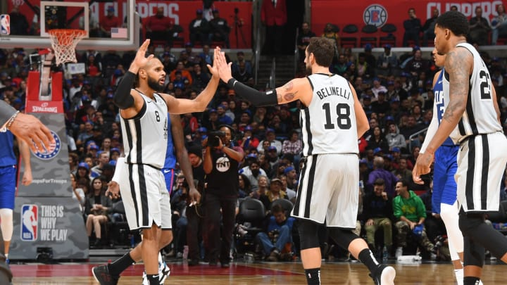 LOS ANGELES, CA – NOVEMBER 15: Patty Mills #8 and Marco Belinelli #18 of the San Antonio Spurs high-five during a game against the LA Clippers at STAPLES Center on November 15, 2018 in Los Angeles, California. (Photo by Andrew D. Bernstein/NBAE via Getty Images)