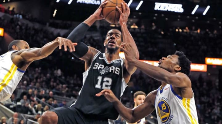SAN ANTONIO, TX - NOVEMBER 18: LaMarcus Aldridge #12 of the San Antonio Spurs drives for two between Andre Iguodala #9 of the Golden State Warriors and Damian Jones #15 of the Golden State Warriors at AT&T Center on November 18 , 2018 in San Antonio, Texas. NOTE TO USER: User expressly acknowledges and agrees that , by downloading and or using this photograph, User is consenting to the terms and conditions of the Getty Images License Agreement. (Photo by Ronald Cortes/Getty Images)