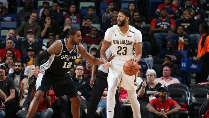 NEW ORLEANS, LA – NOVEMBER 19: Anthony Davis #23 of the New Orleans Pelicans handles the ball against LaMarcus Aldridge #12 of the San Antonio Spurs on November 19, 2018 at Smoothie King Center in New Orleans, Louisiana. (Photo by Layne Murdoch Jr./NBAE via Getty Images)