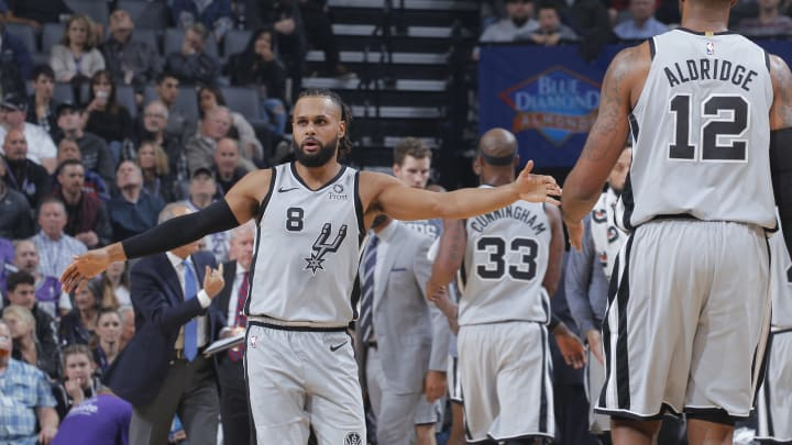 SACRAMENTO, CA – NOVEMBER 12: Patty Mills #8 of the San Antonio Spurs high fives a teammate during the game against the Sacramento Kings on November 12, 2018 at Golden 1 Center in Sacramento, California. (Photo by Rocky Widner/NBAE via Getty Images)