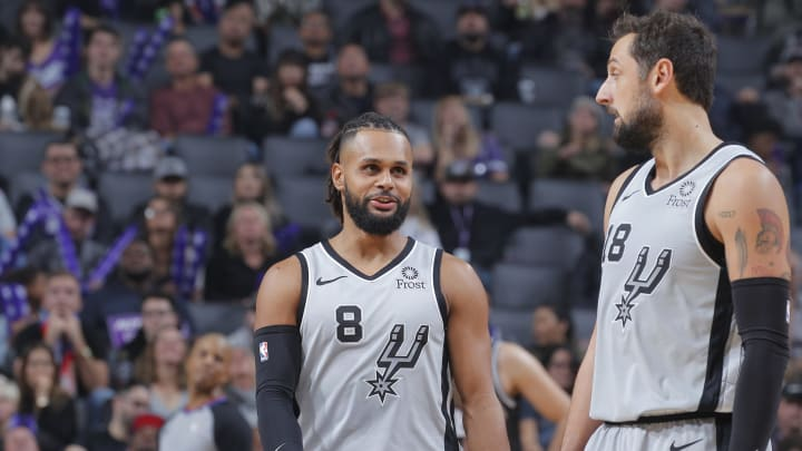 SACRAMENTO, CA – NOVEMBER 12: Patty Mills #8 and Marco Belinelli #18 of the San Antonio Spurs talk during the game against the Sacramento Kings on November 12, 2018 at Golden 1 Center in Sacramento, California. (Photo by Rocky Widner/NBAE via Getty Images)