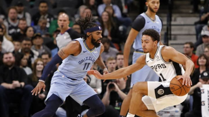 SAN ANTONIO, TX - NOVEMBER 21: Bryn Forbes #11 of the San Antonio Spurs looks for room around Mike Conley #11 of the Memphis Grizzlies during an NBA game (Photo by Edward A. Ornelas/Getty Images)