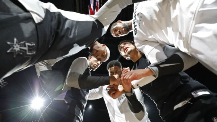 SAN ANTONIO, TX - NOVEMBER 21: Dante Cunningham #33 of the San Antonio Spurs, and teammates DeMar DeRozan #10, Rudy Gay #22, Bryn Forbes #11 and LaMarcus Aldridge #12 huddle before an NBA game against the Memphis Grizzlies (Photo by Edward A. Ornelas/Getty Images)