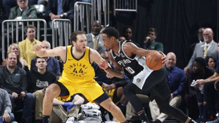 INDIANAPOLIS, IN - NOVEMBER 23: DeMar DeRozan #10 of the San Antonio Spurs handles the ball while defended by Bojan Bogdanovic #44 of the Indiana Pacers in the first half of the game at Bankers Life Fieldhouse on November 23, 2018 in Indianapolis, Indiana. NOTE TO USER: User expressly acknowledges and agrees that, by downloading and or using the photograph, User is consenting to the terms and conditions of the Getty Images License Agreement. (Photo by Joe Robbins/Getty Images)