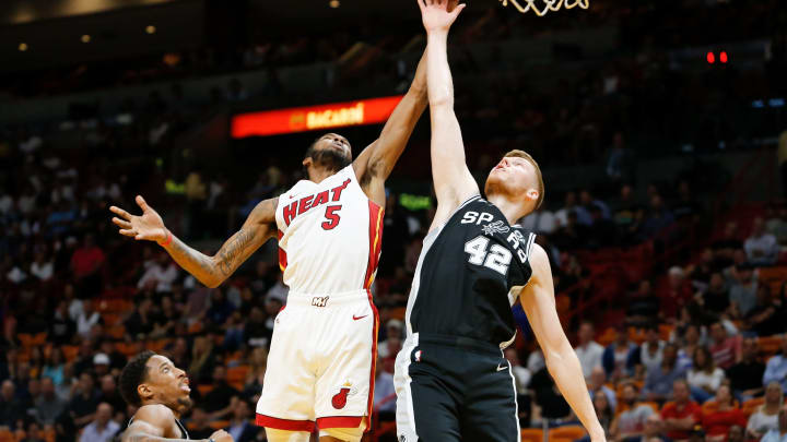 MIAMI, FL – NOVEMBER 07: Derrick Jones Jr. #5 of the Miami Heat battles for a rebound with Davis Bertans #42 of the San Antonio Spurs at American Airlines Arena on November 7, 2018 in Miami, Florida. (Photo by Michael Reaves/Getty Images)