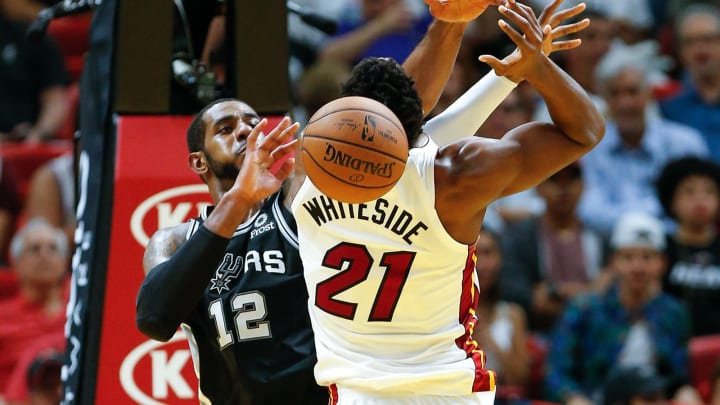 MIAMI, FL – NOVEMBER 07: LaMarcus Aldridge #12 of the San Antonio Spurs blocks a shot by Hassan Whiteside #21 of the Miami Heat (Photo by Michael Reaves/Getty Images)