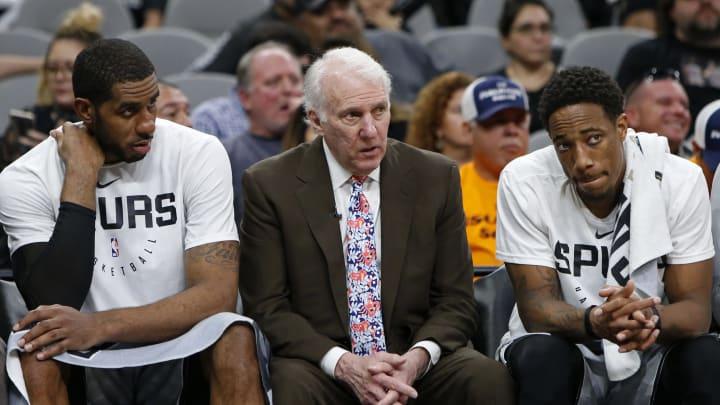 SAN ANTONIO, TX – NOVEMBER 30: Gregg Popovich head coach of the San Antonio Spurs talks with players LaMarcus Aldridge #12, and DeMar DeRozan #10 on the bench (Photo by Edward A. Ornelas/Getty Images)