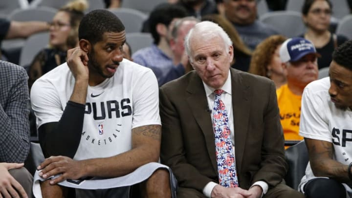 SAN ANTONIO, TX - NOVEMBER 30: Gregg Popovich head coach of the San Antonio Spurs talks with players Pau Gasol #16, LaMarcus Aldridge #12, and DeMar DeRozan #10 on the bench during an NBA game against the Houston Rockets. (Photo by Edward A. Ornelas/Getty Images)