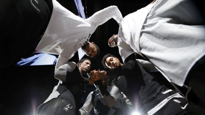 SAN ANTONIO, TX - NOVEMBER 30: Rudy Gay #22 of the San Antonio Spurs, with teammates DeMar DeRozan #10, Dante Cunningham #33, Bryn Forbes #11, and LaMarcus Aldridge #12 huddle before an NBA game against the Houston Rockets held November 30, 2018 at the AT&T Center in San Antonio, Texas. NOTE TO USER: User expressly acknowledges and agrees that, by downloading and or using this photograph, User is consenting to the terms and conditions of the Getty Images License Agreement. (Photo by Edward A. Ornelas/Getty Images)