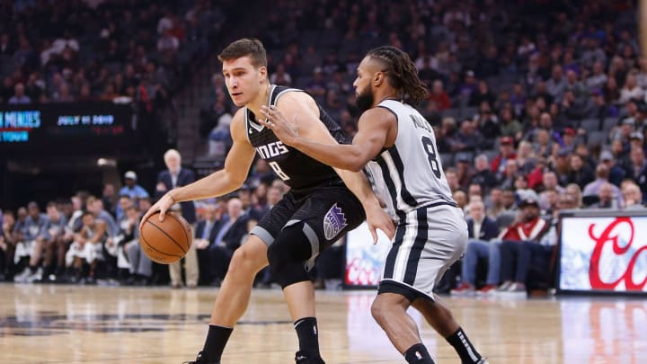 SACRAMENTO, CA – NOVEMBER 12: Bogdan Bogdanovic #8 of the Sacramento Kings looks to get by Patty Mills #8 of the San Antonio Spurs at Golden 1 Center on November 12, 2018. (Photo by Lachlan Cunningham/Getty Images)