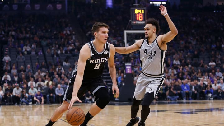 SACRAMENTO, CA – NOVEMBER 12: Bogdan Bogdanovic #8 of the Sacramento Kings looks to get by Derrick White #4 of the San Antonio Spurs at Golden 1 Center (Photo by Lachlan Cunningham/Getty Images)