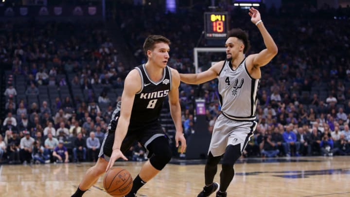 SACRAMENTO, CA - NOVEMBER 12: Bogdan Bogdanovic #8 of the Sacramento Kings looks to get by Derrick White #4 of the San Antonio Spurs at Golden 1 Center (Photo by Lachlan Cunningham/Getty Images)