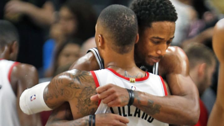 SAN ANTONIO, TX - DECEMBER 2: DeMar DeRozan #10 of the San Antonio Spurs hugs Damian Lillard #0 of the Portland Trail Blazers at the end of the game at AT&T Center on December 2 , 2018 in San Antonio, Texas. NOTE TO USER: User expressly acknowledges and agrees that , by downloading and or using this photograph, User is consenting to the terms and conditions of the Getty Images License Agreement. (Photo by Ronald Cortes/Getty Images)