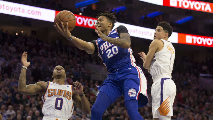 PHILADELPHIA, PA – NOVEMBER 19: Markelle Fultz #20 of the Philadelphia 76ers shoots the ball against Isaiah Canaan #0 and Devin Booker #1 of the Phoenix Suns at the Wells Fargo Center on November 19, 2018 in Philadelphia, Pennsylvania. (Photo by Mitchell Leff/Getty Images)