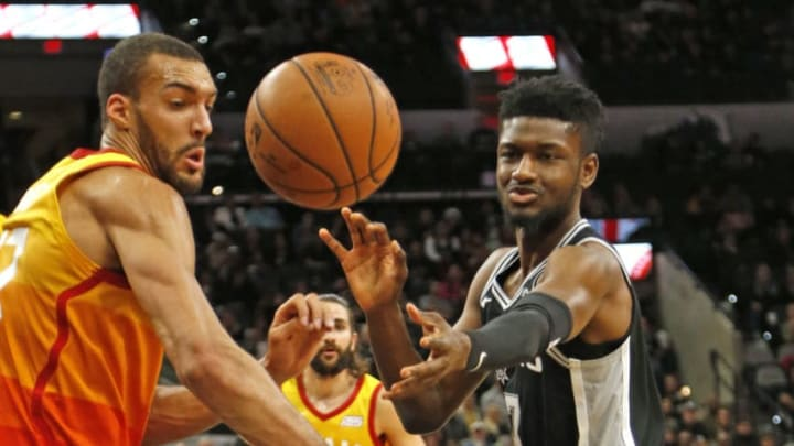 SAN ANTONIO,TX - DECEMBER 09: Chimezie Metu #7 of the San Antonio Spurs and Rudy Gobert #27 of the Utah Jazz watch the ball go out of bounds at AT&T Center (Photo by Ronald Cortes/Getty Images)