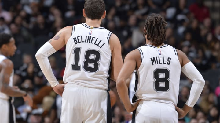 SAN ANTONIO, TX – DECEMBER 11: Marco Belinelli #18 of the San Antonio Spurs and Patty Mills #8 of the San Antonio Spurs seen on court during the game (Photos by Mark Sobhani/NBAE via Getty Images)