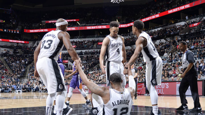 SAN ANTONIO, TX – DECEMBER 11: The San Antonio Spurs huddle up during the game against the Phoenix Suns (Photos by Mark Sobhani/NBAE via Getty Images)