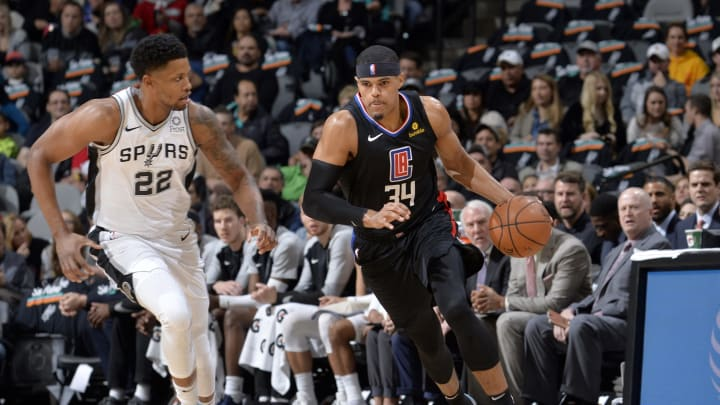 SAN ANTONIO, TX – DECEMBER 13: Tobias Harris #34 of the LA Clippers handles the ball during the game against Rudy Gay #22 of the San Antonio Spurs (Photos by Mark Sobhani/NBAE via Getty Images)