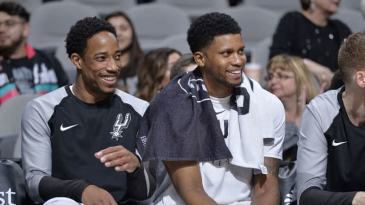 SAN ANTONIO, TX - DECEMBER 13: DeMar DeRozan #10 of the San Antonio Spurs and Rudy Gay #22 talk on the bench during the game against the LA Clippers on December 13, 2018 at the AT&T Center in San Antonio, Texas. NOTE TO USER: User expressly acknowledges and agrees that, by downloading and or using this photograph, user is consenting to the terms and conditions of the Getty Images License Agreement. Mandatory Copyright Notice: Copyright 2018 NBAE (Photos by Mark Sobhani/NBAE via Getty Images)