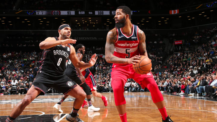 NEW YORK, NY – DECEMBER 14: Markieff Morris #5 of the Washington Wizards passes the ball during the game against Jared Dudley #6 of the Brooklyn Nets on December 14, 2018 at Barclays Center in New York, NY. (Photo by Ned Dishman/NBAE via Getty Images)