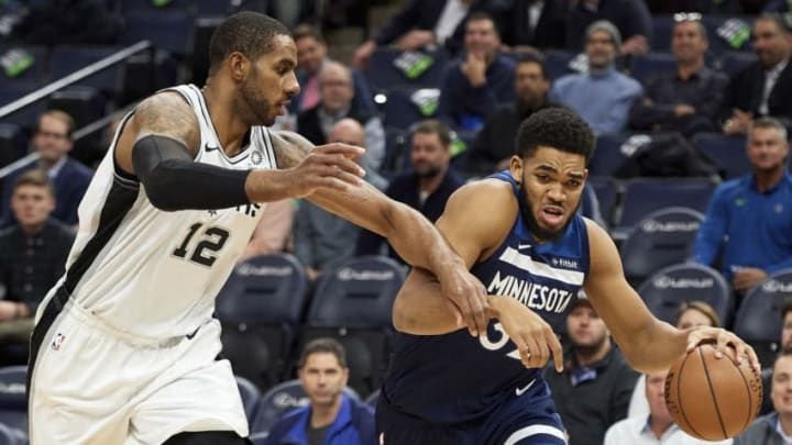 MINNEAPOLIS, MN - NOVEMBER 28: Karl-Anthony Towns #32 of the Minnesota Timberwolves drives to the basket against LaMarcus Aldridge #12 of the San Antonio Spurs (Photo by Hannah Foslien/Getty Images)