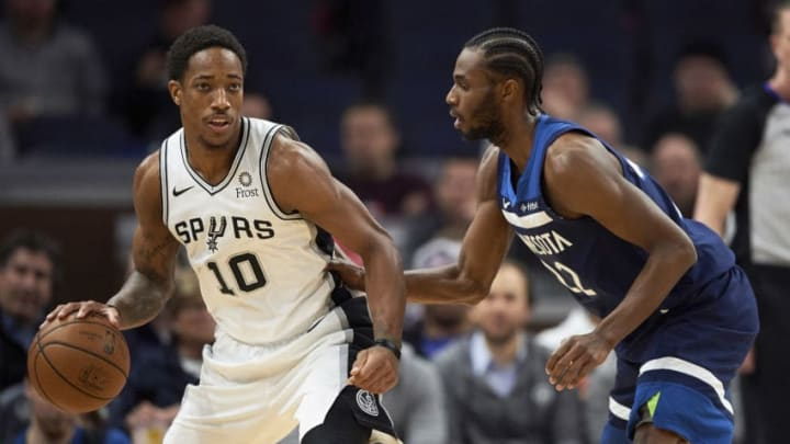 MINNEAPOLIS, MN - NOVEMBER 28: Andrew Wiggins #22 of the Minnesota Timberwolves defends against DeMar DeRozan #10 of the San Antonio Spurs during the game on November 28, 2018 at the Target Center in Minneapolis, Minnesota. NOTE TO USER: User expressly acknowledges and agrees that, by downloading and or using this Photograph, user is consenting to the terms and conditions of the Getty Images License Agreement. (Photo by Hannah Foslien/Getty Images)