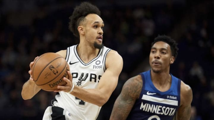 MINNEAPOLIS, MN - NOVEMBER 28: Derrick White #4 of the San Antonio Spurs drives to the basket against Jeff Teague #0 of the Minnesota Timberwolves during the game on November 28, 2018 at the Target Center in Minneapolis, Minnesota. NOTE TO USER: User expressly acknowledges and agrees that, by downloading and or using this Photograph, user is consenting to the terms and conditions of the Getty Images License Agreement. (Photo by Hannah Foslien/Getty Images)