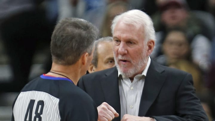 SAN ANTONIO,TX – DECEMBER 17: Gregg Popvich head coach of the San Antonio Spurs confers with official Scott Foster during game against the Philadelphia 76ers at AT&T Center on December 17, 2018 in San Antonio, Texas. (Photo by Ronald Cortes/Getty Images)
