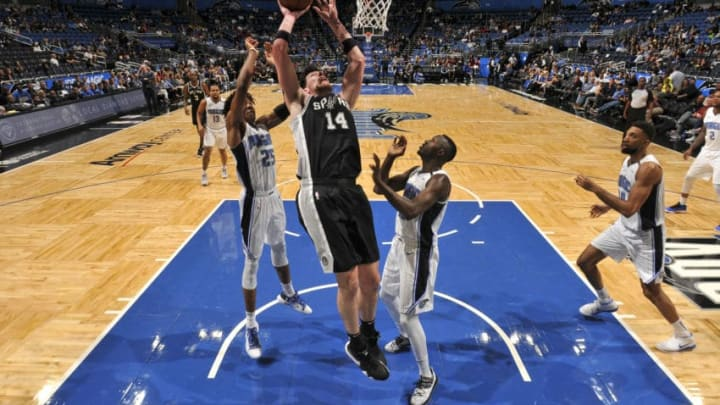 ORLANDO, FL - DECEMBER 19: Drew Eubanks #14 of the San Antonio Spurs shoots the ball against the Orlando Magic on December 19, 2018 at Amway Center in Orlando, Florida. NOTE TO USER: User expressly acknowledges and agrees that, by downloading and or using this photograph, User is consenting to the terms and conditions of the Getty Images License Agreement. Mandatory Copyright Notice: Copyright 2018 NBAE (Photo by Fernando Medina/NBAE via Getty Images)