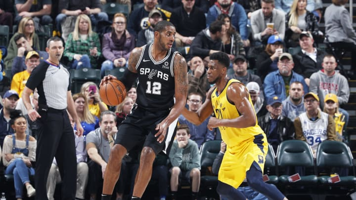 INDIANAPOLIS, IN – NOVEMBER 23: LaMarcus Aldridge #12 of the San Antonio Spurs looks to the basket against Thaddeus Young #21 of the Indiana Pacers (Photo by Joe Robbins/Getty Images)