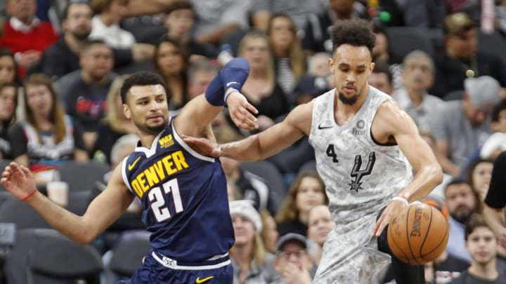 SAN ANTONIO,TX – DECEMBER 26: Derrick White #4 of the San Antonio Spurs steals the ball from Jamal Murray of the Denver Nuggets at AT&T Center on December 26, 2018 in San Antonio, Texas. (Photo by Ronald Cortes/Getty Images)