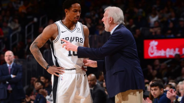 DENVER, CO - DECEMBER 28: Demar Derozan #10 speaks with Head Coach Gregg Popovich of the San Antonio Spurs during the game against the Denver Nuggets on December 28, 2018 at the Pepsi Center in Denver, Colorado. NOTE TO USER: User expressly acknowledges and agrees that, by downloading and/or using this Photograph, user is consenting to the terms and conditions of the Getty Images License Agreement. Mandatory Copyright Notice: Copyright 2018 NBAE (Photo by Bart Young/NBAE via Getty Images)