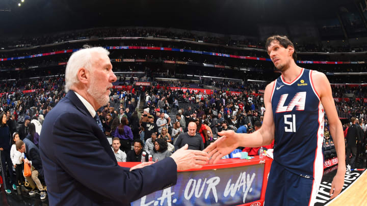 LOS ANGELES, CA – DECEMBER 29: Head Coach Gregg Popovich of the San Antonio Spurs greets Boban Marjanovic #51 of the LA Clippers after the game (Photo by Andrew D. Bernstein/NBAE via Getty Images)