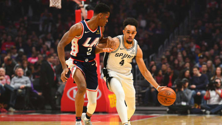 LOS ANGELES, CA - DECEMBER 29: San Antonio Spurs Forward Derrick White (4) brings the ball up the court under pressure from Los Angeles Clippers Guard Shai Gilgeous-Alexander (2) during a NBA game between the San Antonio Spurs and the Los Angeles Clippers on December 29, 2018 at STAPLES Center in Los Angeles, CA. (Photo by Brian Rothmuller/Icon Sportswire via Getty Images)